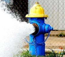 image of fire hydrant spraying water